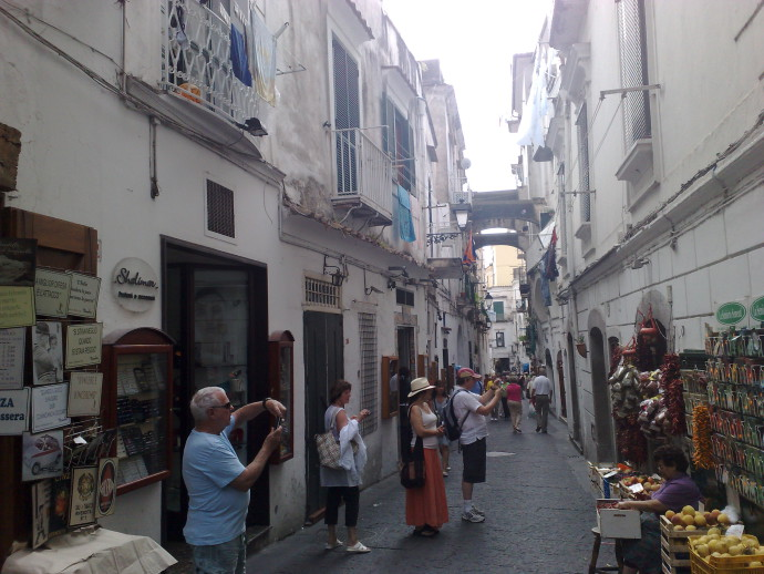 The tourists swarm in the narrow streets of Amalfi
